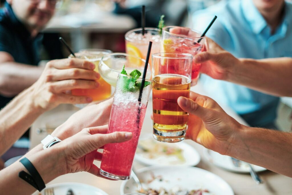 Close up image of people drinking cocktails
